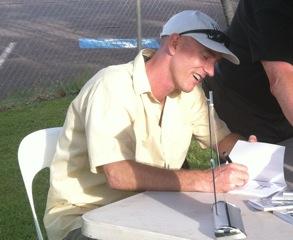 Hazel's son Trev signing books